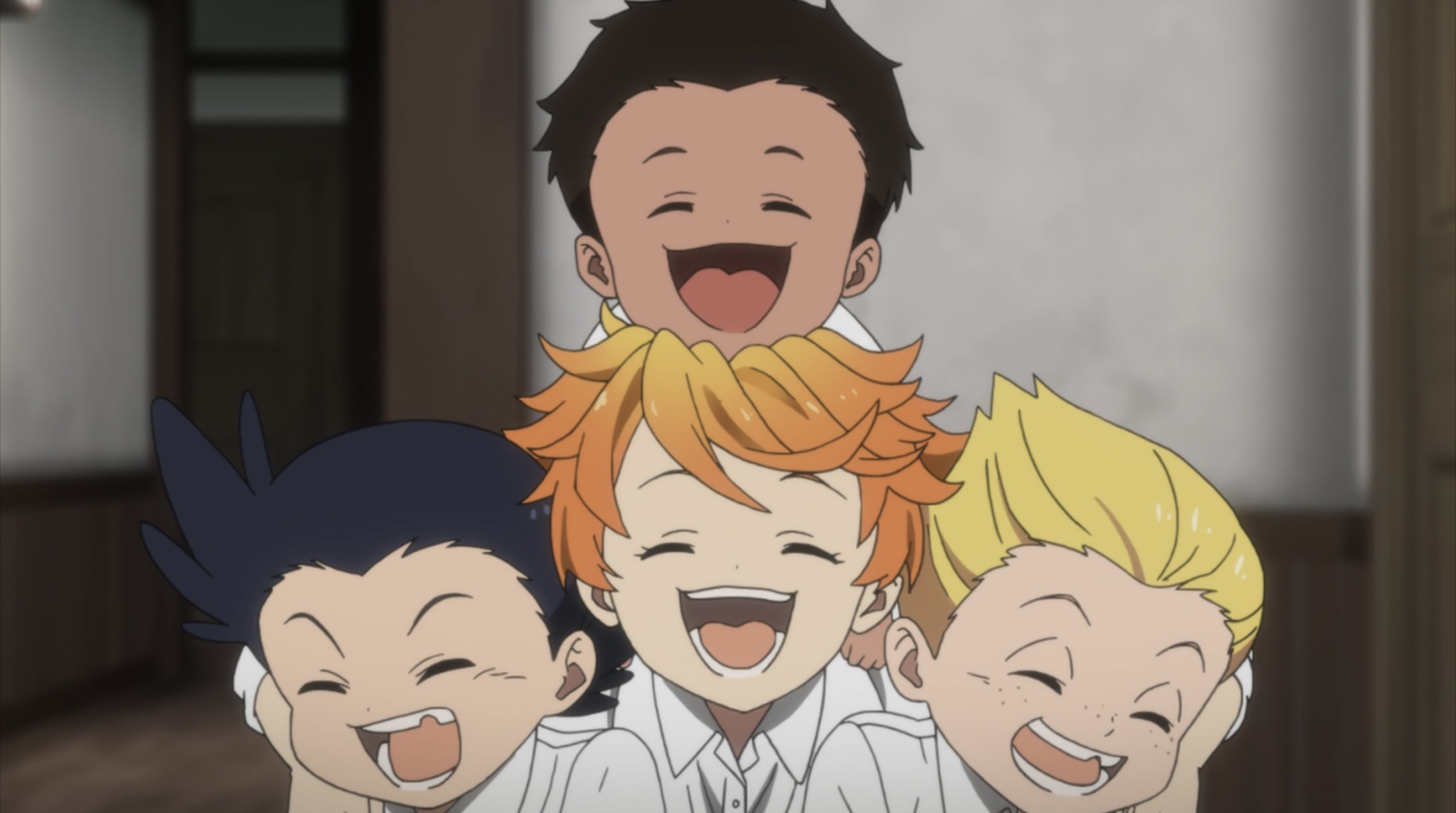 """Emma and her """"siblings"""" smiling happily"""