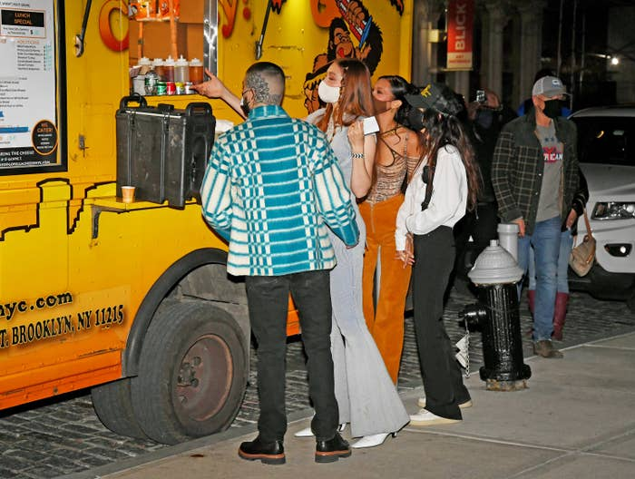 Gigi, Bella, and Zayn standing in front of the food truck in New York City