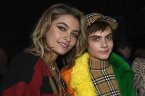 Paris Jackson (L) and Cara Delevingne wearing Burberry at the Burberry February 2018 show during London Fashion Week