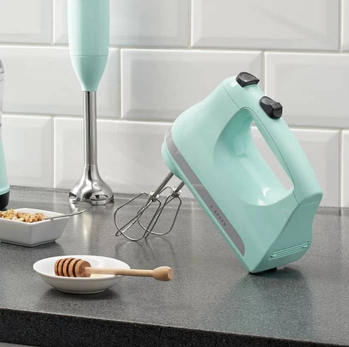 The five-speed hand mixer in ice blue with an imulsion attachment