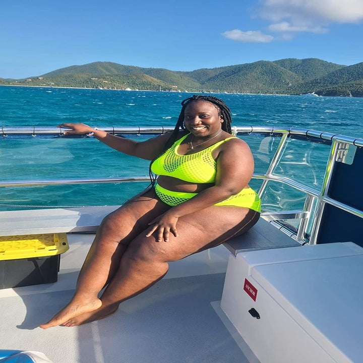 reviewer wearing the neon yellow bikini