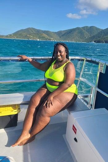 reviewer wearing the neon yellow bikini