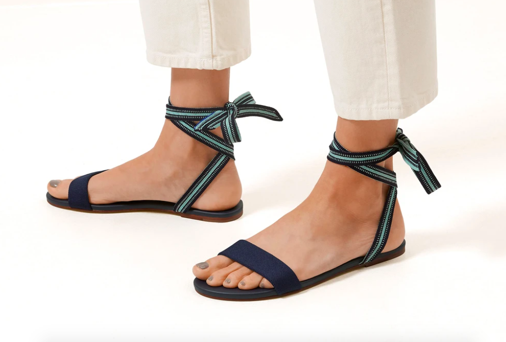 A model wearing the Rothy sandals