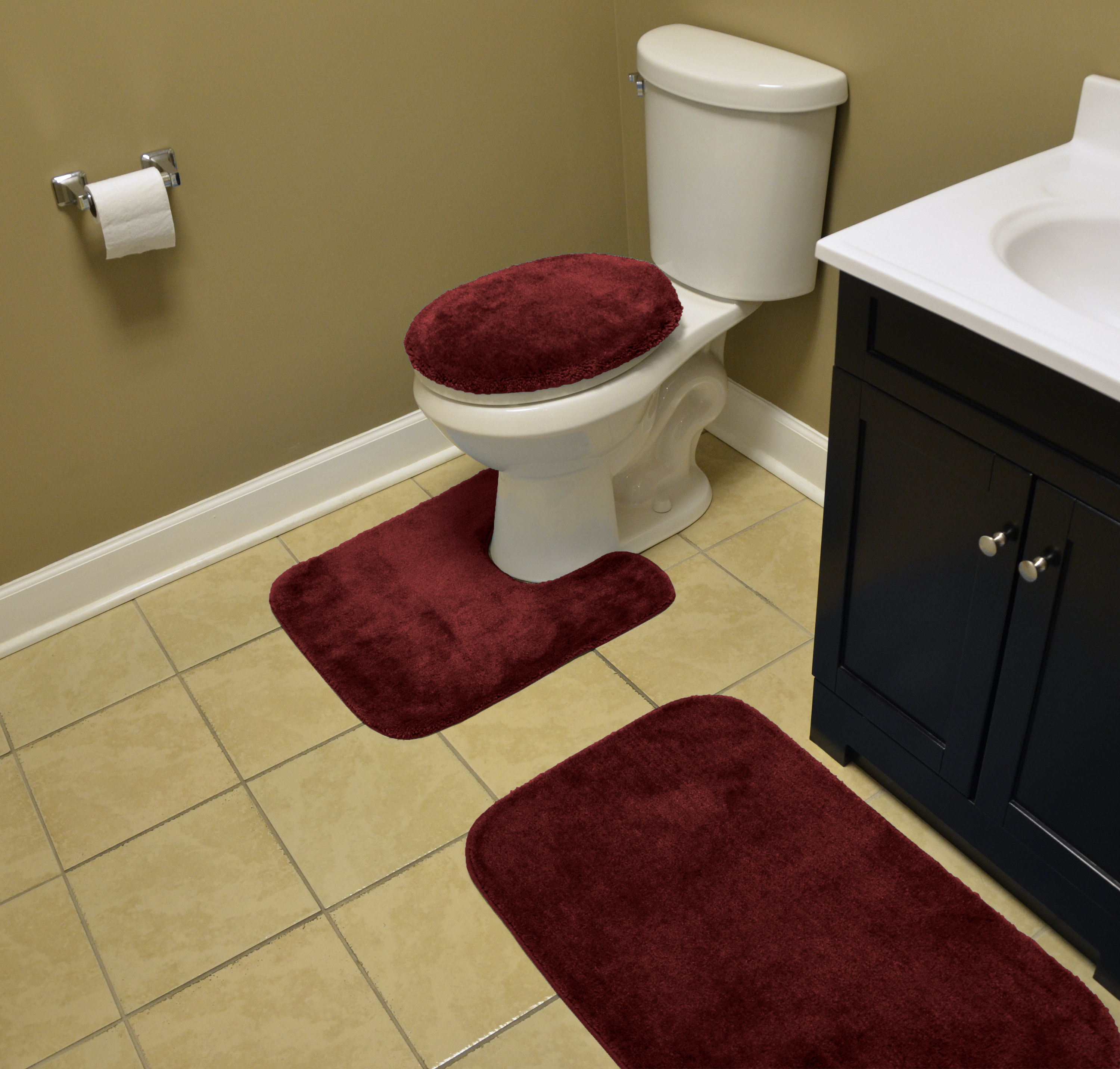 A red set of bathroom rugs in a home