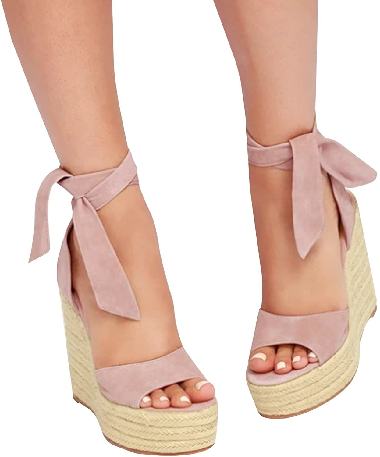 A model wearing the four-inch wedges in pink