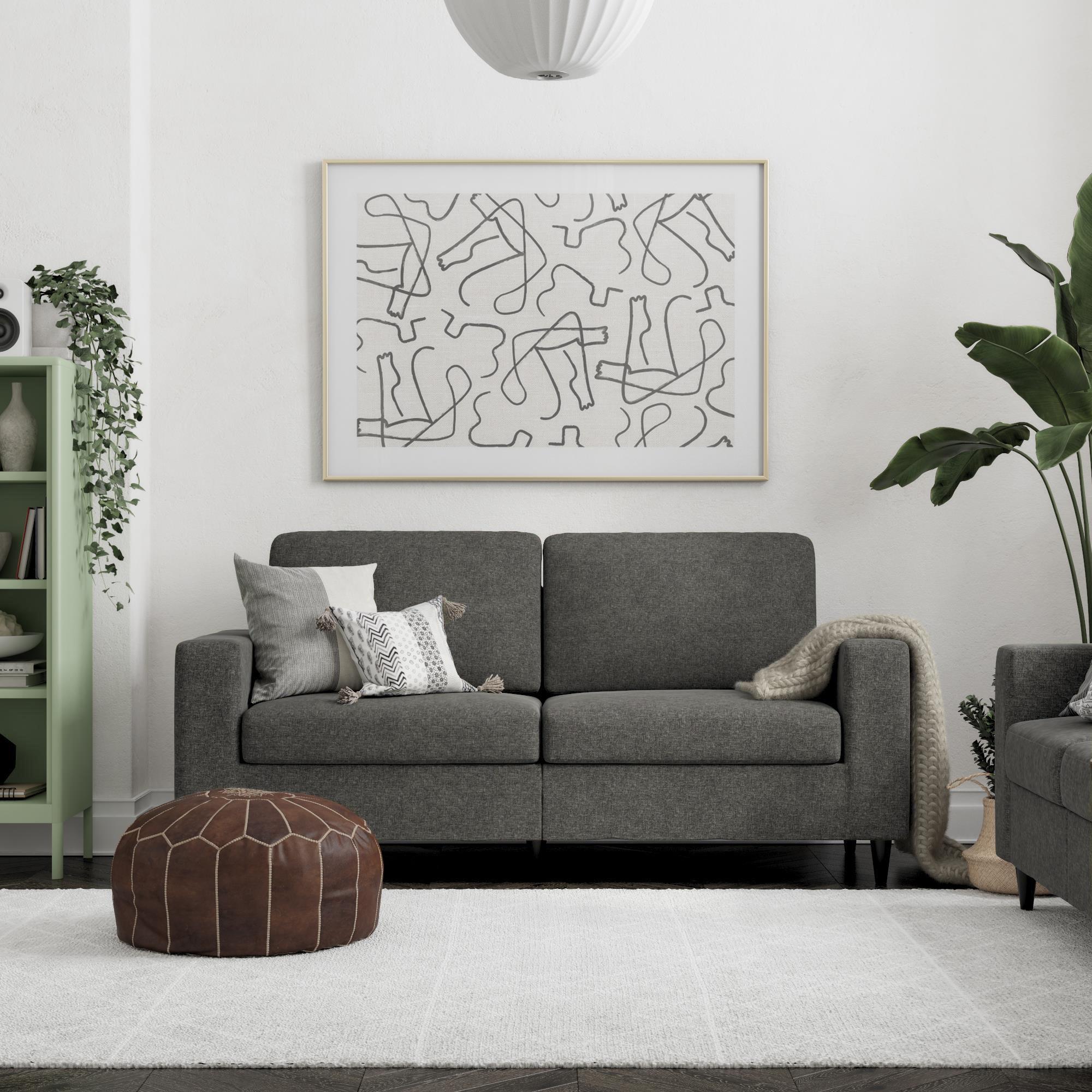 A grey linen sofa in a home