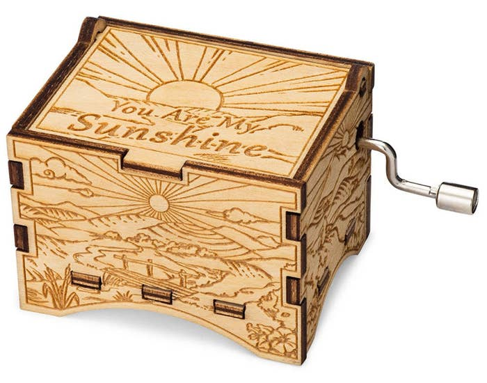 """wooden music box with wind-up crank on side, engraved with message """"You Are My Sunshine"""""""