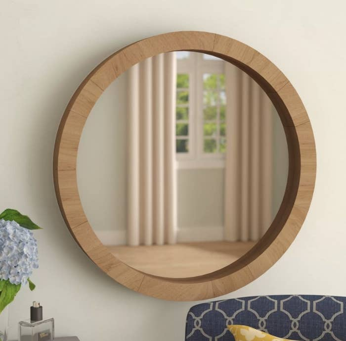 Round wall mirror with wooden border