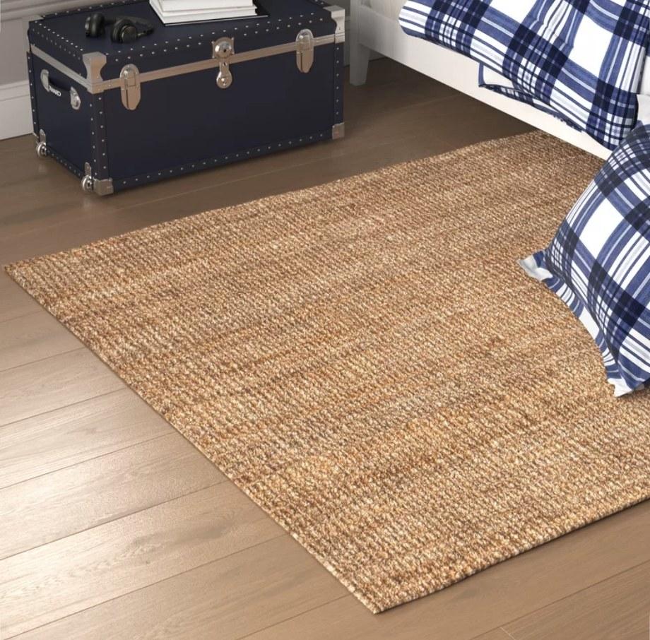 Jute rug on wooden floor