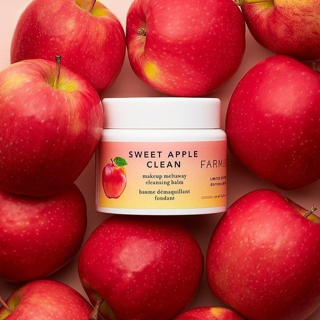 The cleansing balm alongside some apples