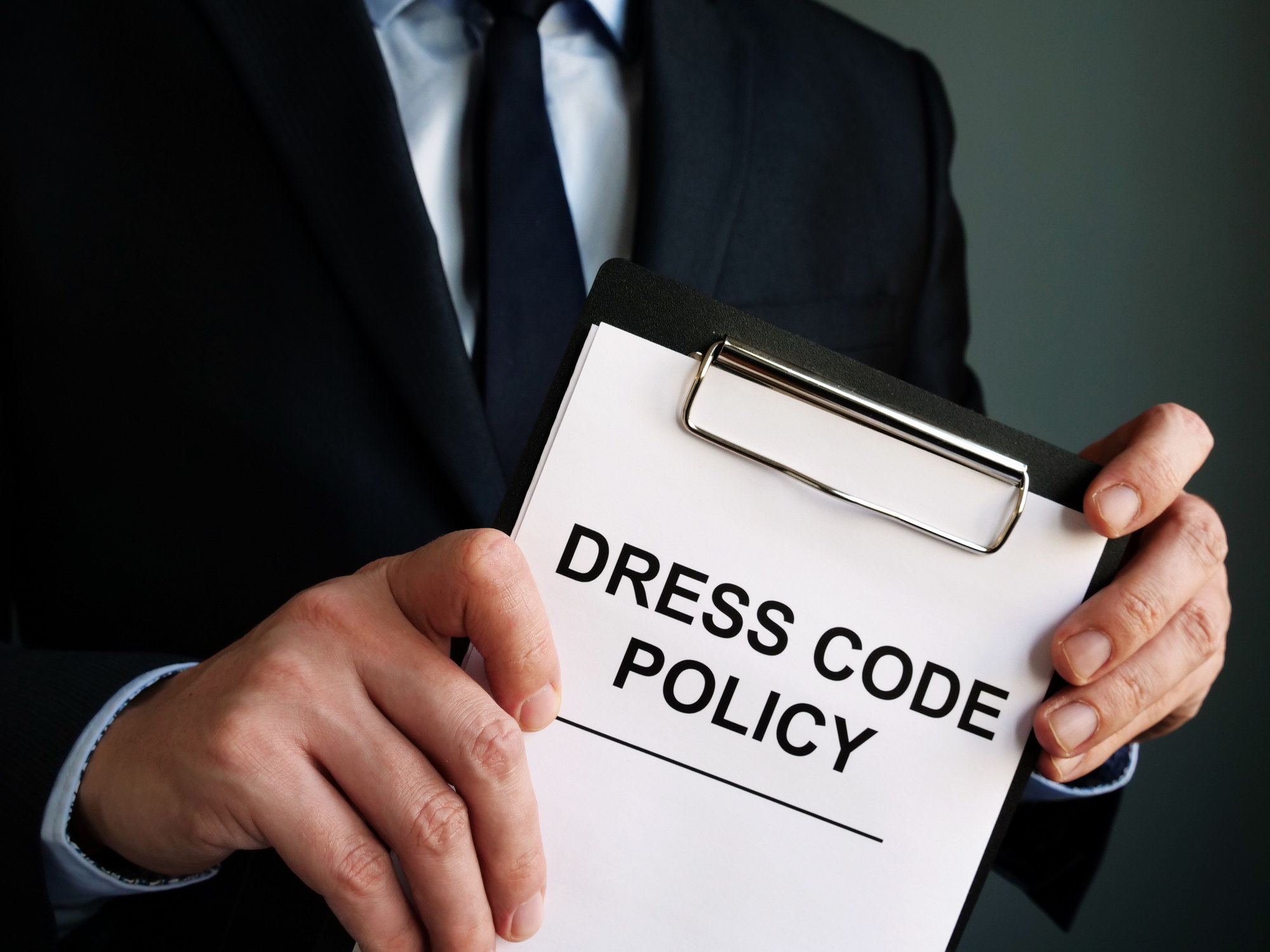 Manager holding Dress code policy