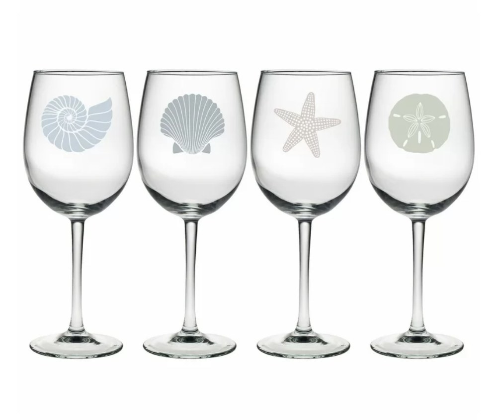 wine glasses with various nautical icons on them