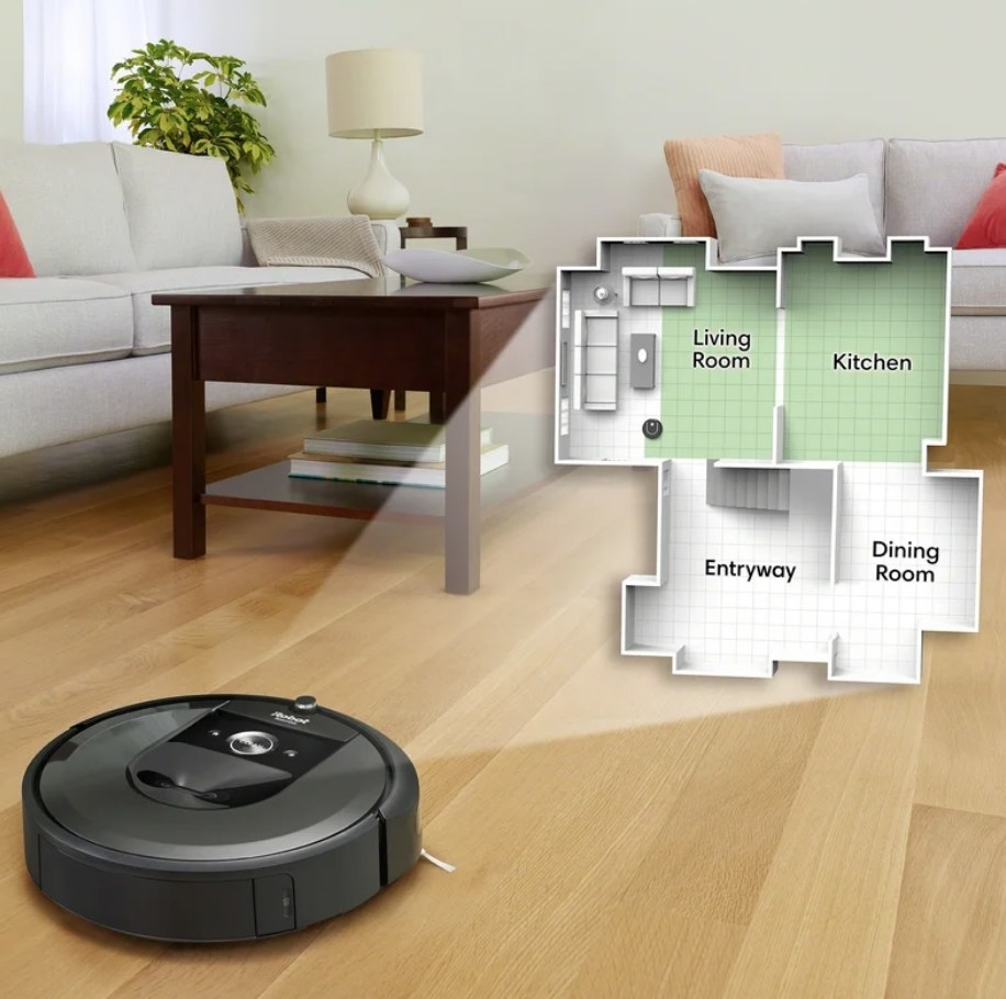 Roomba on living room floor with graphic of house map