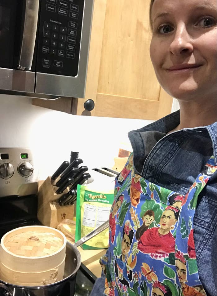 Woman in kitchen with apron on