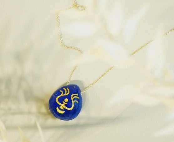 "teardrop shaped lapis lazuli pendant with gold chain and symbol like the one in the movie ""Castle in the Sky"""