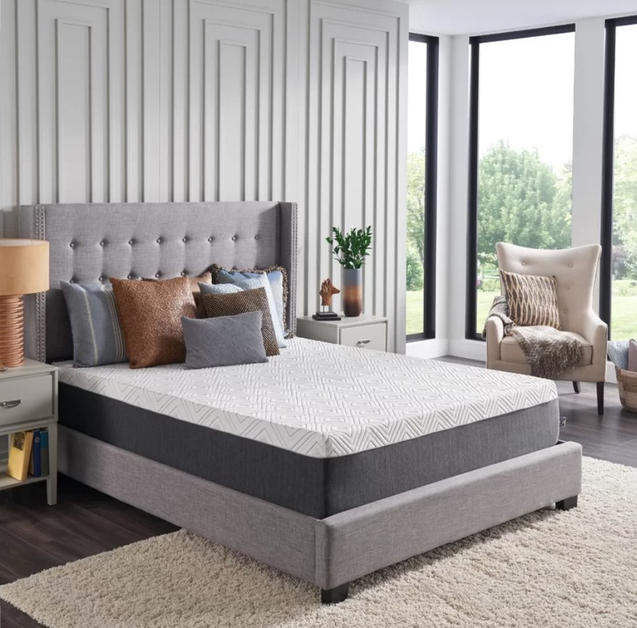 Sealy mattress on gray bedframe