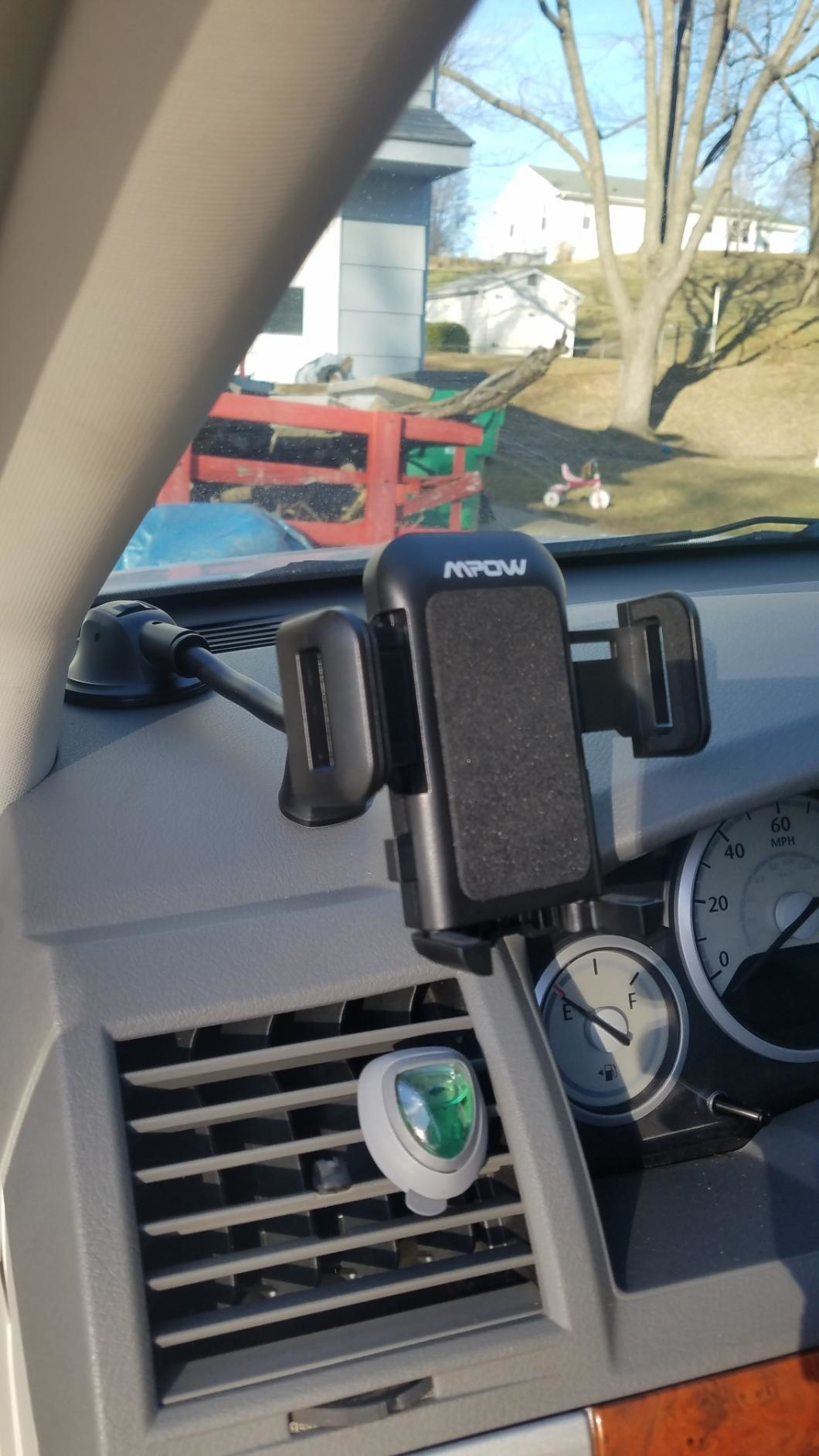 the phone holder attached to a dashboard