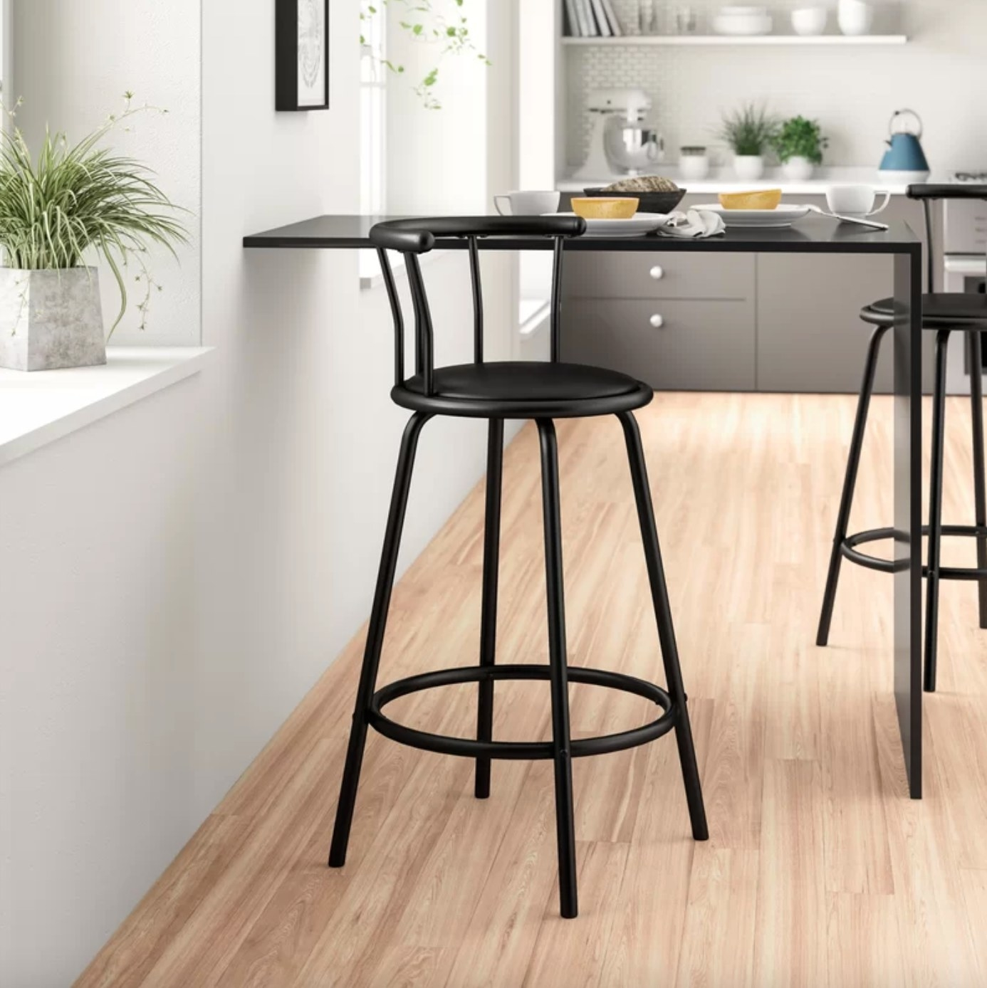 The swivel stool in black at a hightop table