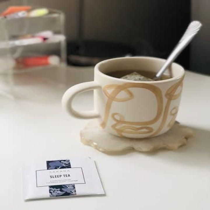 A reviewer's tea and tea bag
