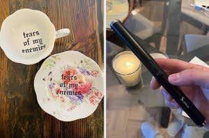 """A set of tea cups that reads, """"tears of my enemies,"""" and a reviewer holding an electric lighter"""