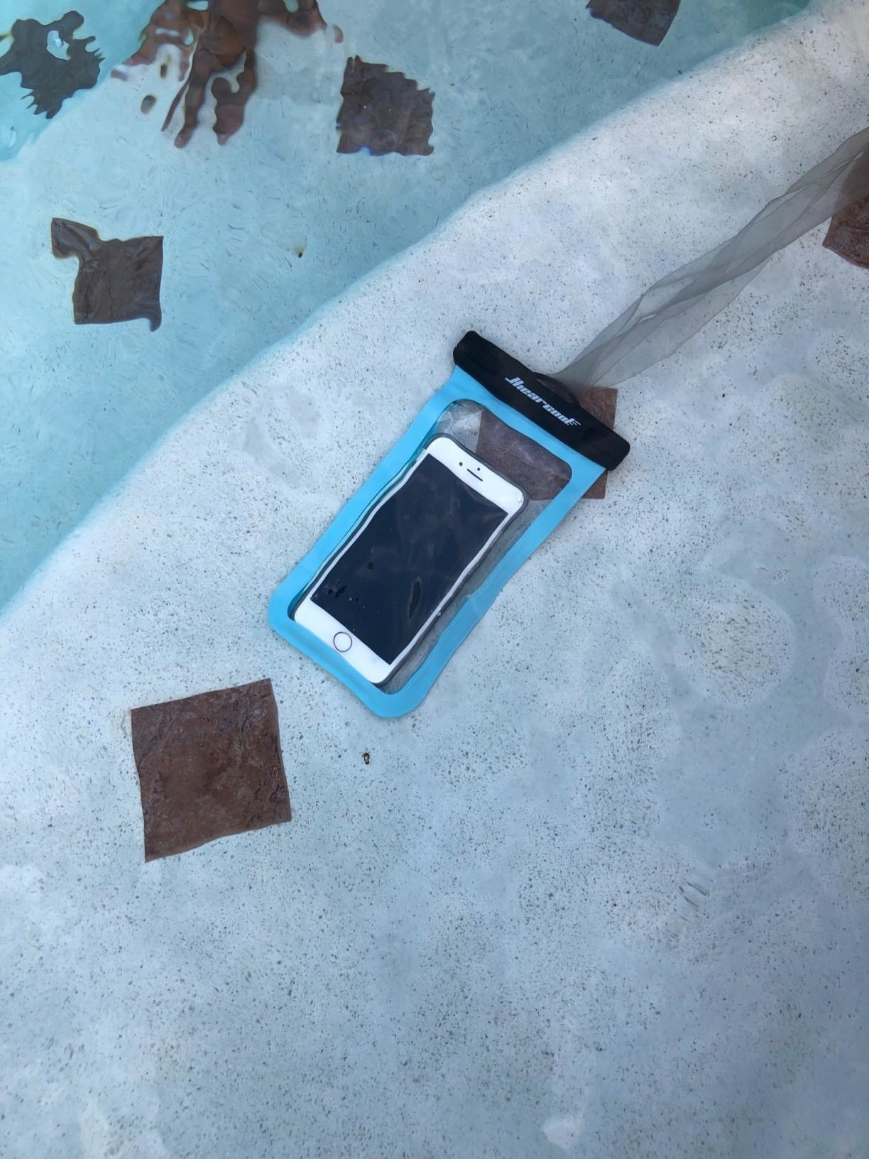 the pouch with a phone inside underwater at a pool