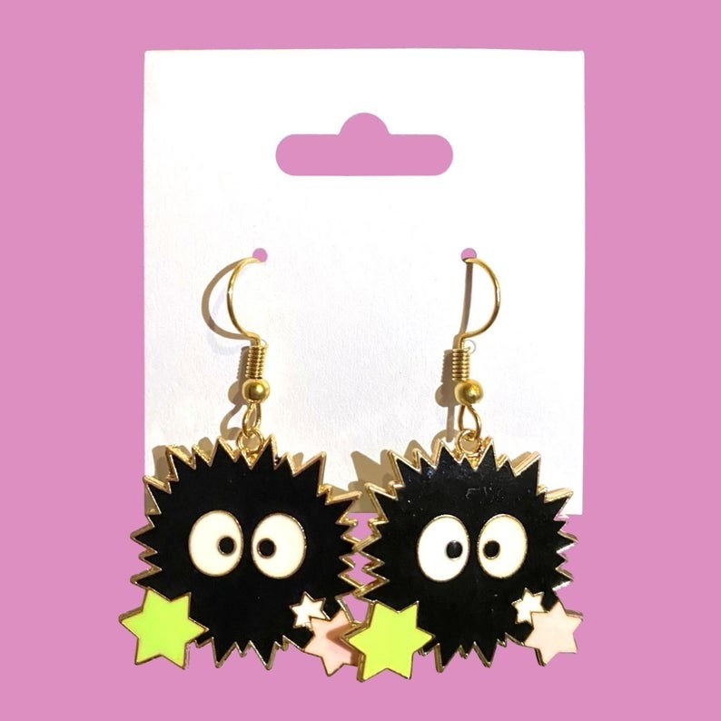 drop earrings shaped like soot sprites with star candy