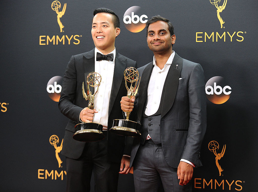 Alan Yang (L) and Aziz Ansari pose in the press room at the 68th annual Primetime Emmy Awards