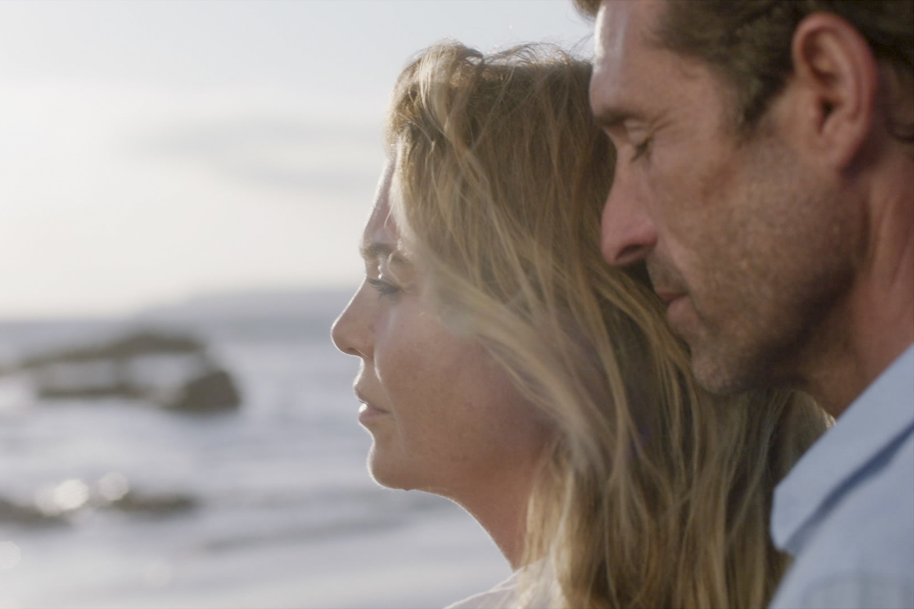 Dempsey and Pompeo look out onto the ocean in Grey's Anatomy