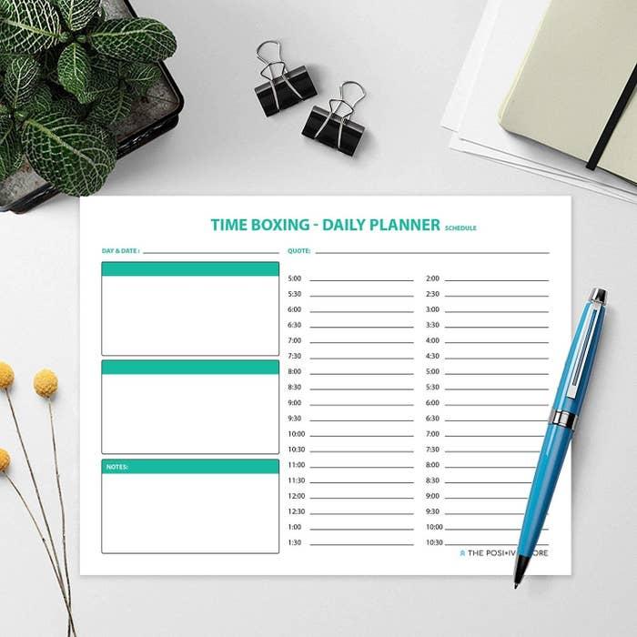 Planner pad kept on a desk.