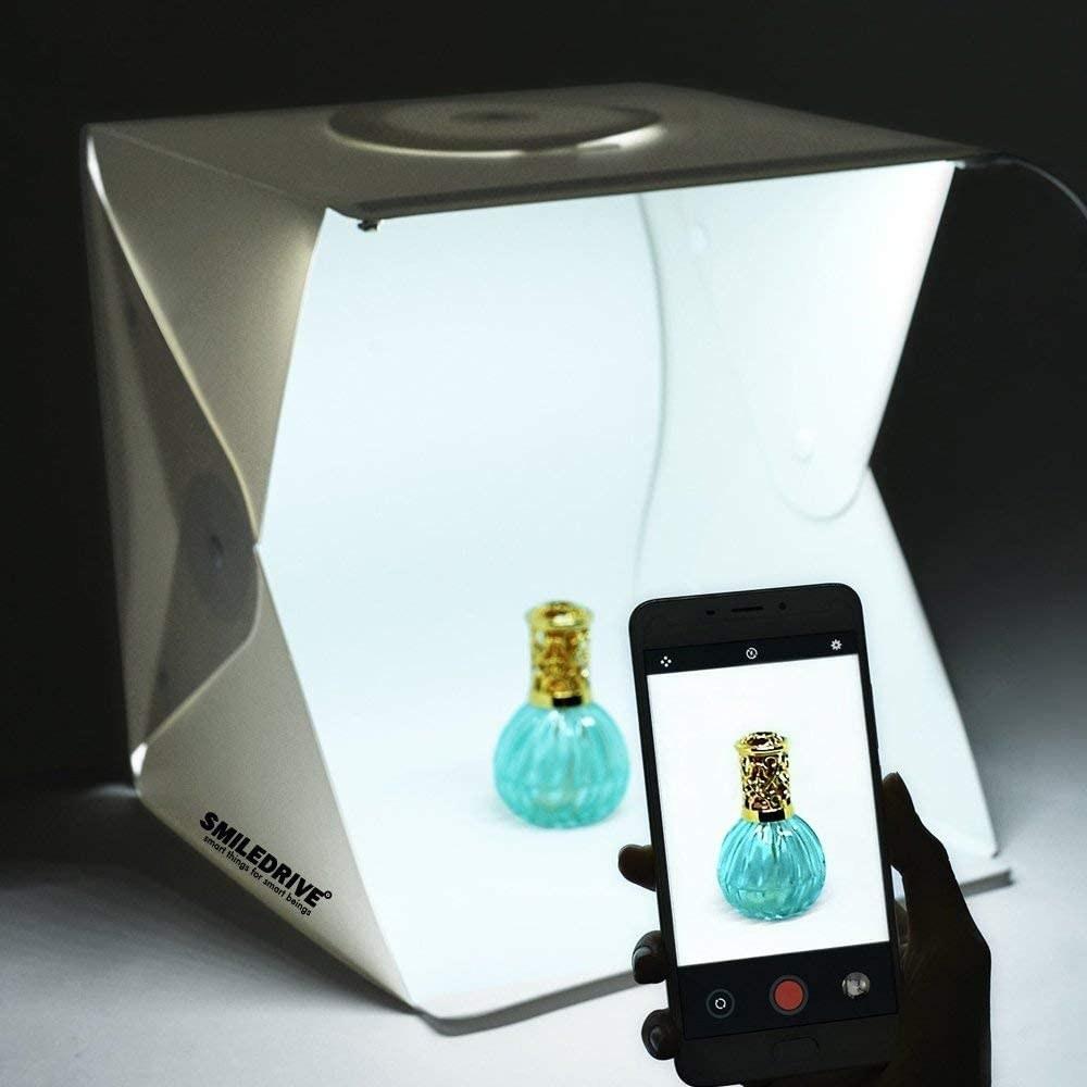 A perfume bottle inside the photo studio.