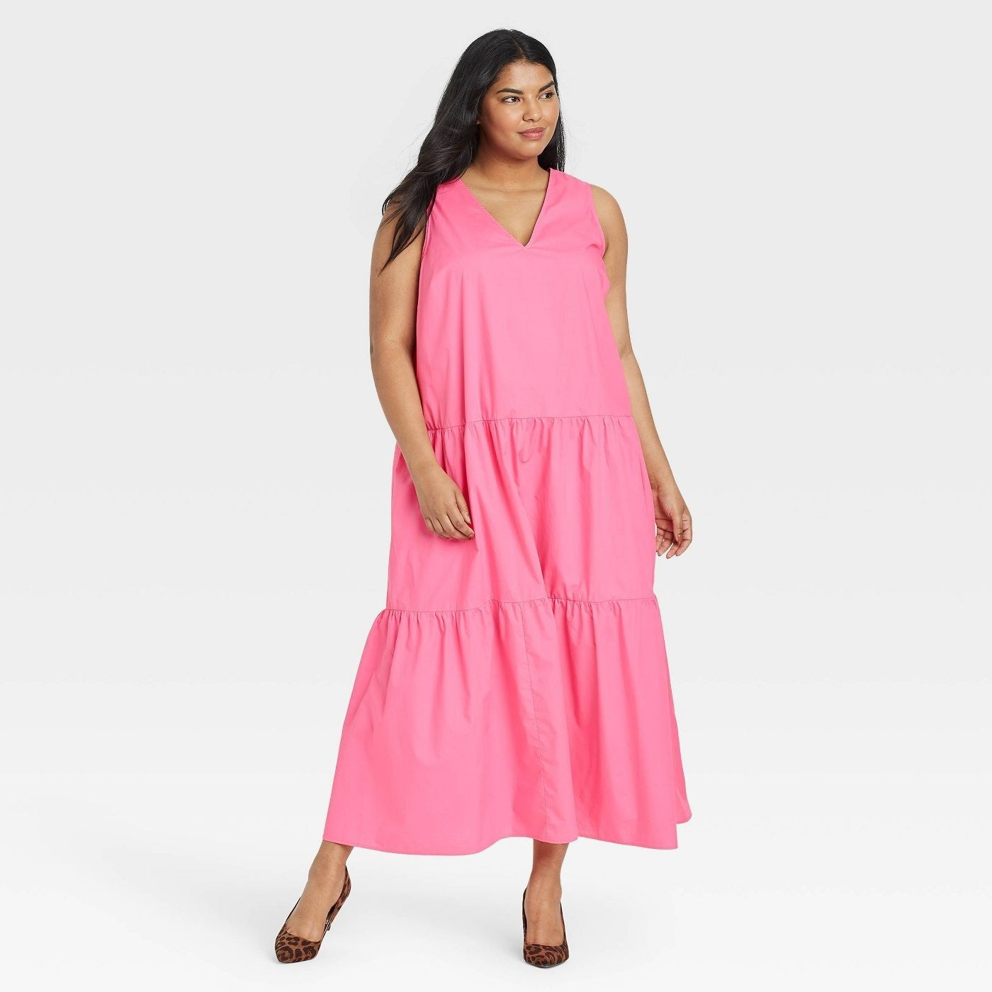 Model wearing pink maxi dress with tiered skirt