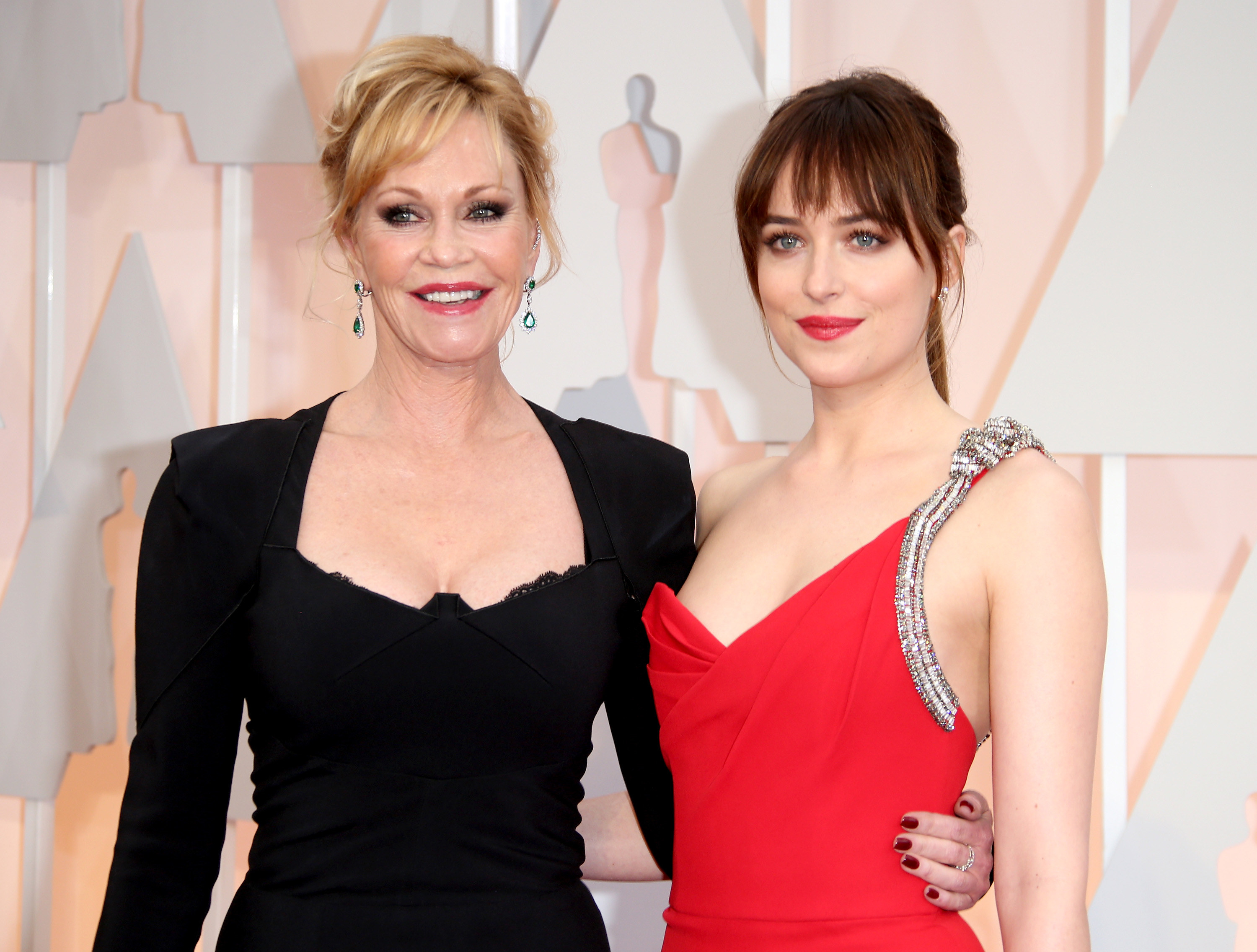 Melanie Griffith and Dakota Johnson in gowns on the red carpet