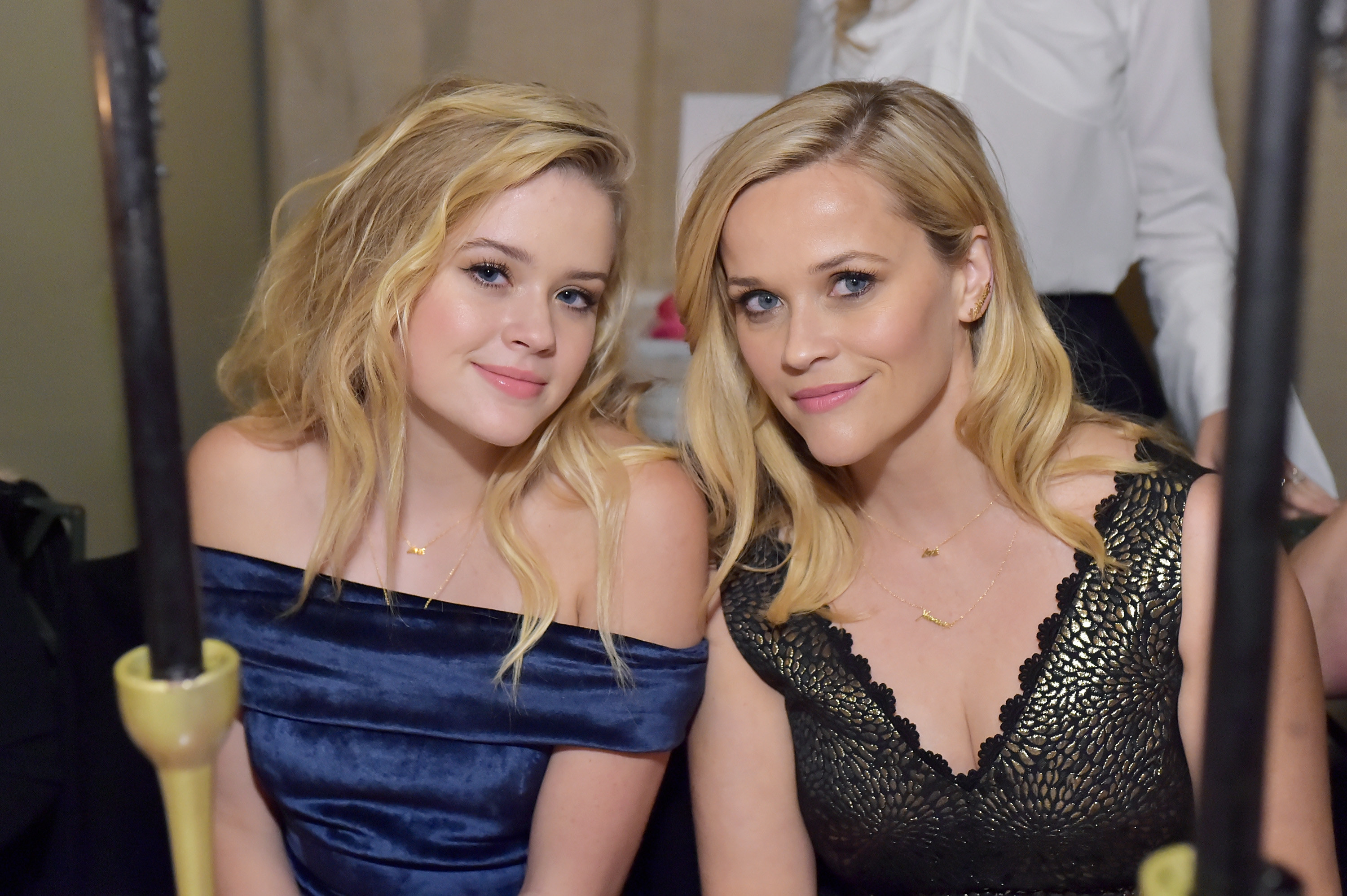 Ava and Reese sit close to each other