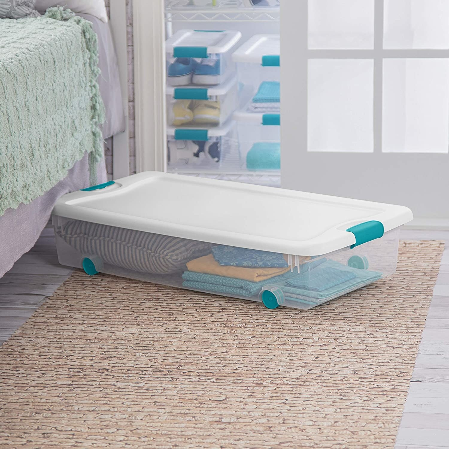 A rolling storage container with a lid in a bedroom