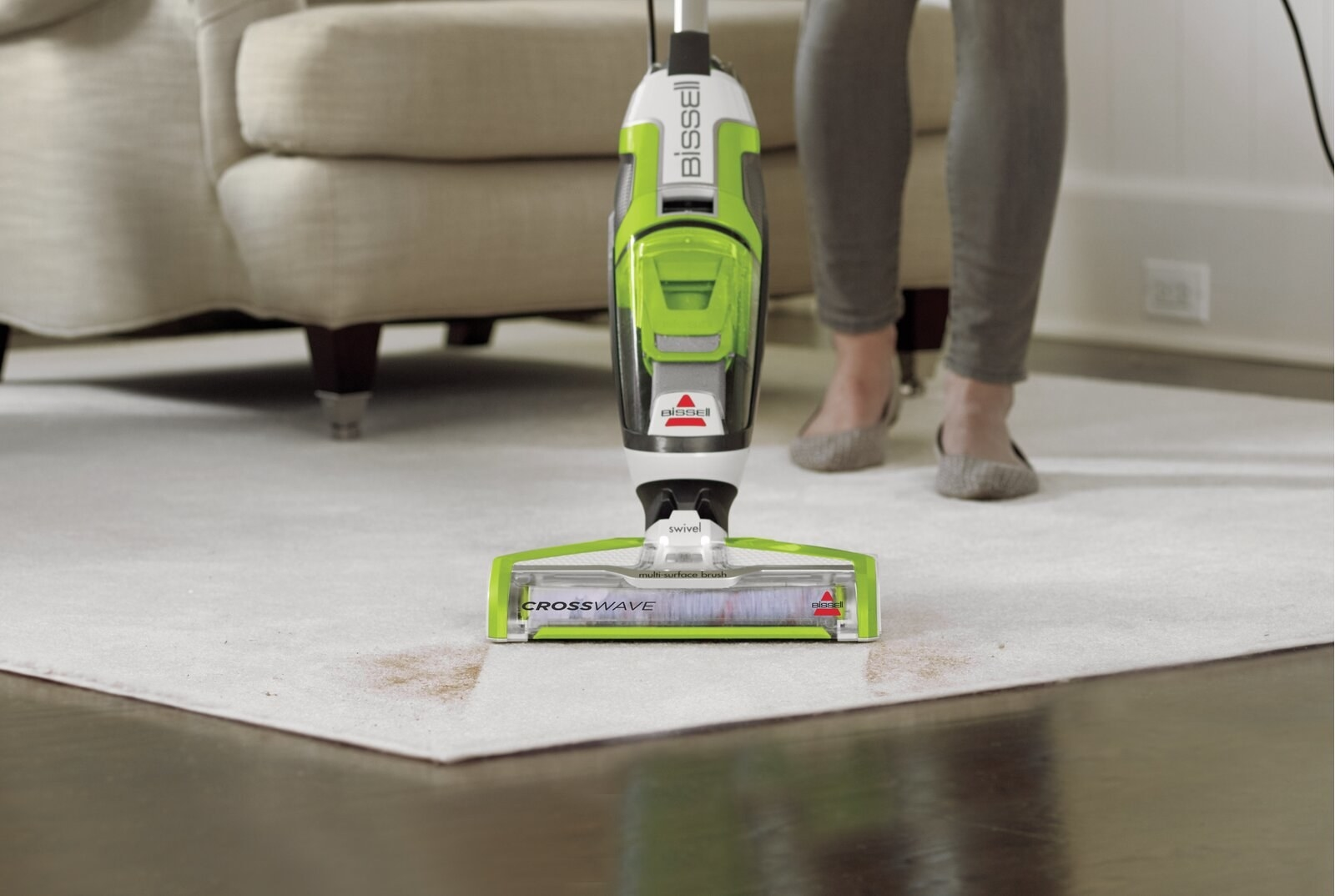 The vacuum, which is bagless, and has a green-and-clear-plastic body