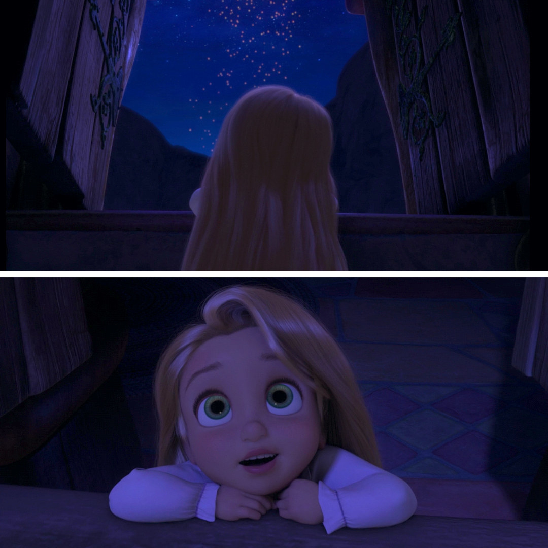 toddler Rapunzel looking at the lanterns in the sky