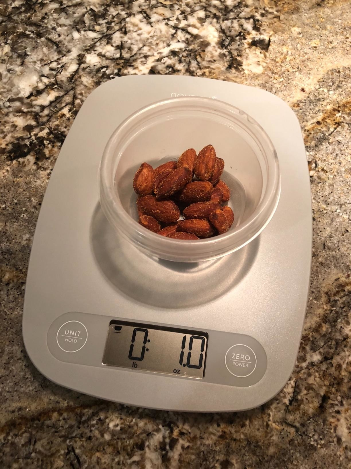 the scale weighing out a portion of almonds