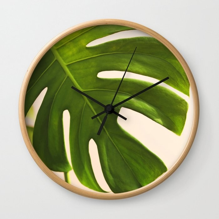 the clock with a leaf print on it