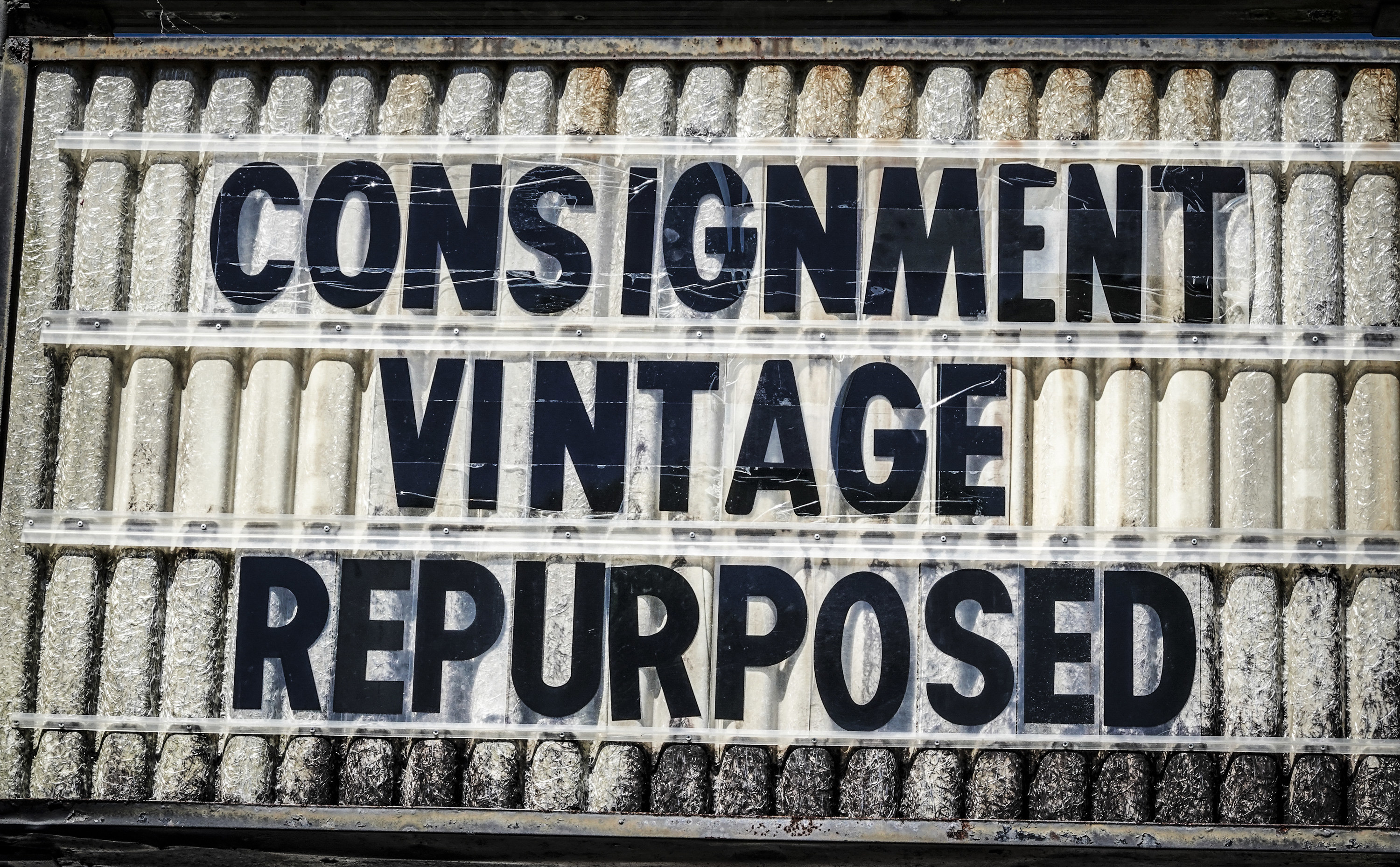 """A sign saying """"Consignment Vintage Repurposed"""""""