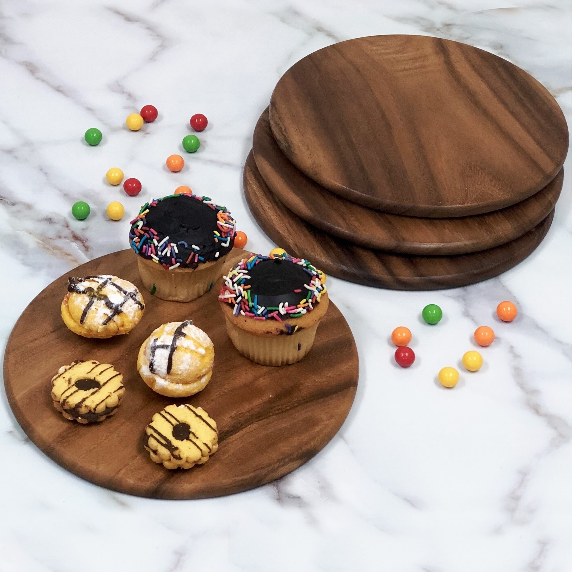 The serving trays with a variety of desserts on top