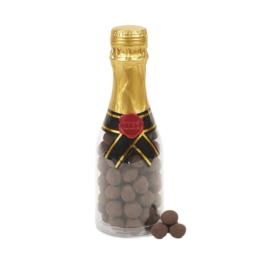 clear champagne bottle with chocolate ball candy inside