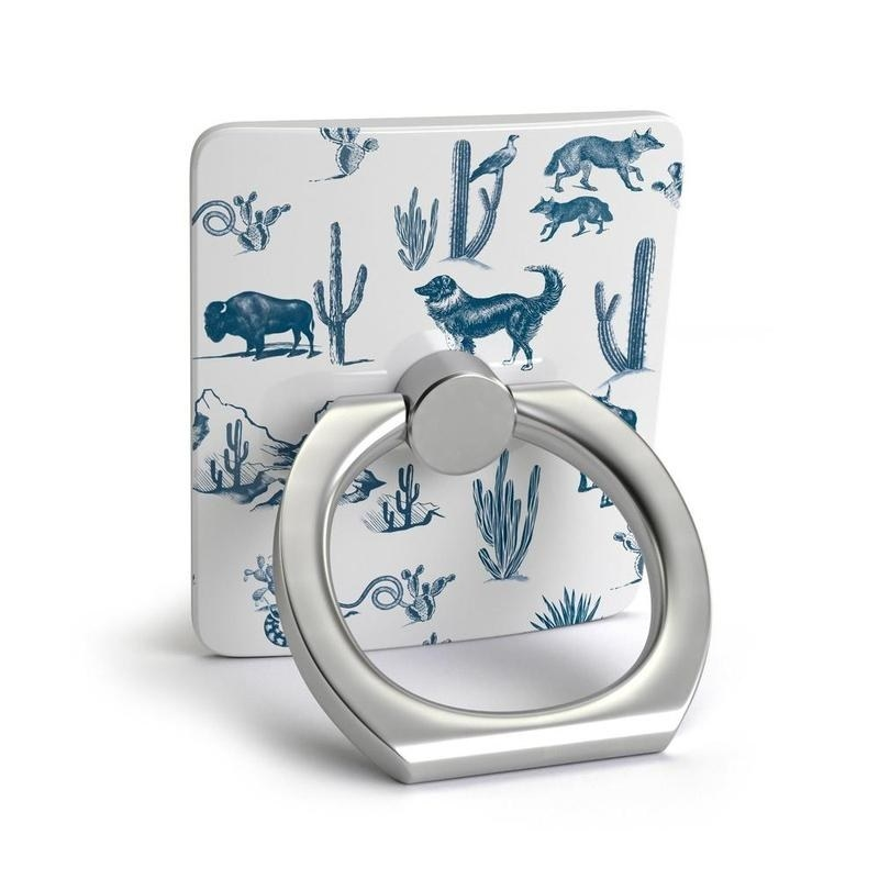 square design with desert illustrations on it connected to a ring to use as a phone stand