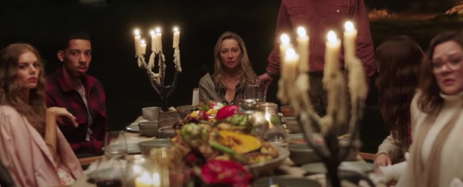 The cast of Nine Perfect Strangers sits at a long dinner table