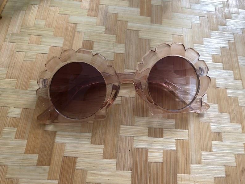 sunglasses with seashell shaped frame