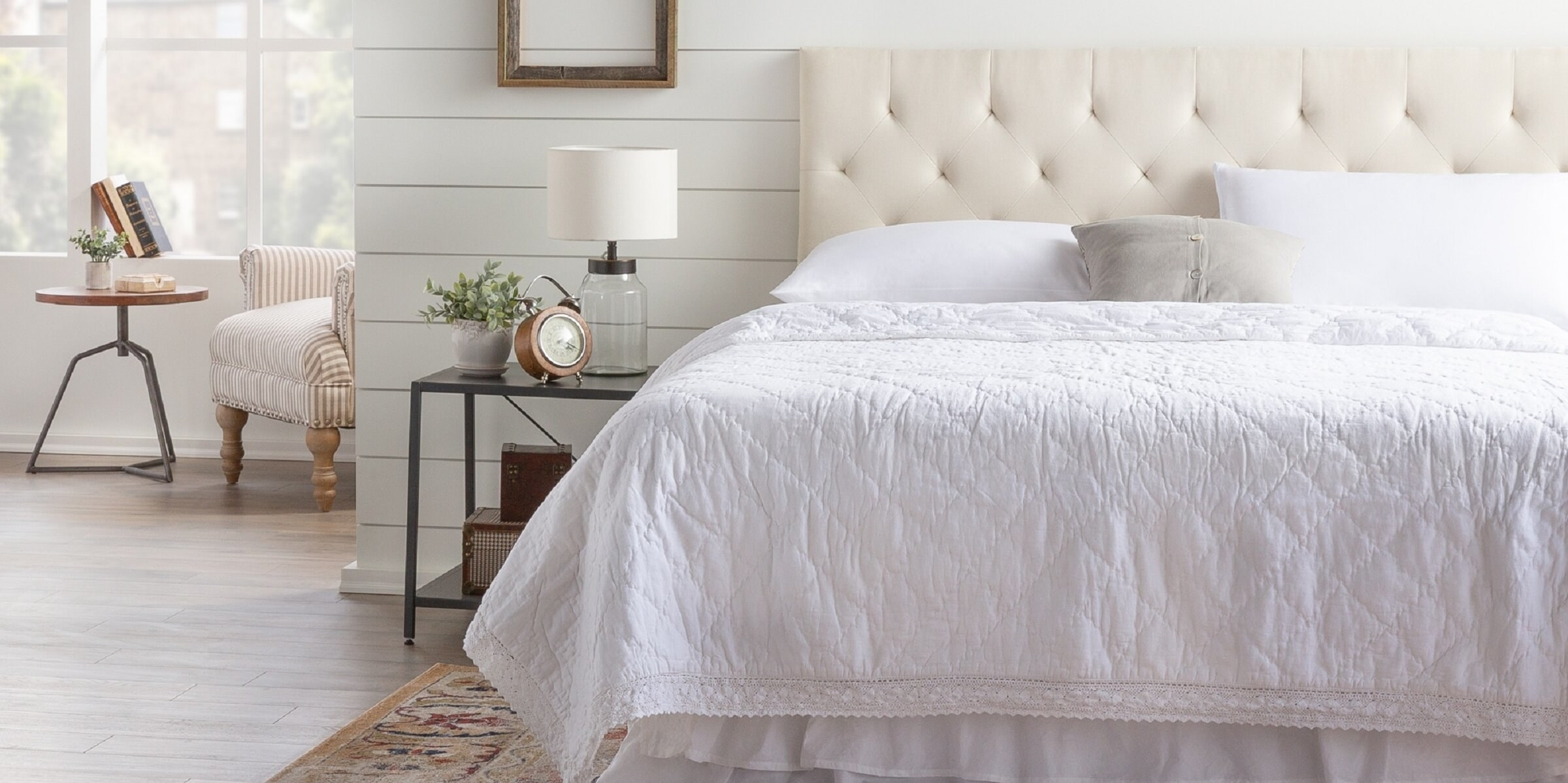 The headboard in a bedroom, in white