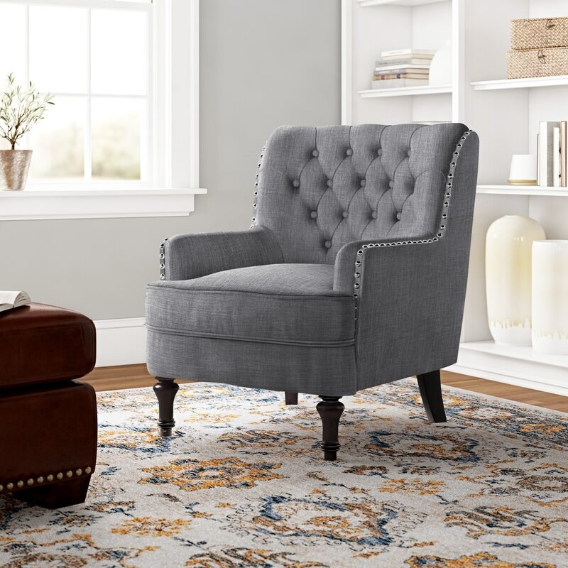 The chair in gray, in a living room