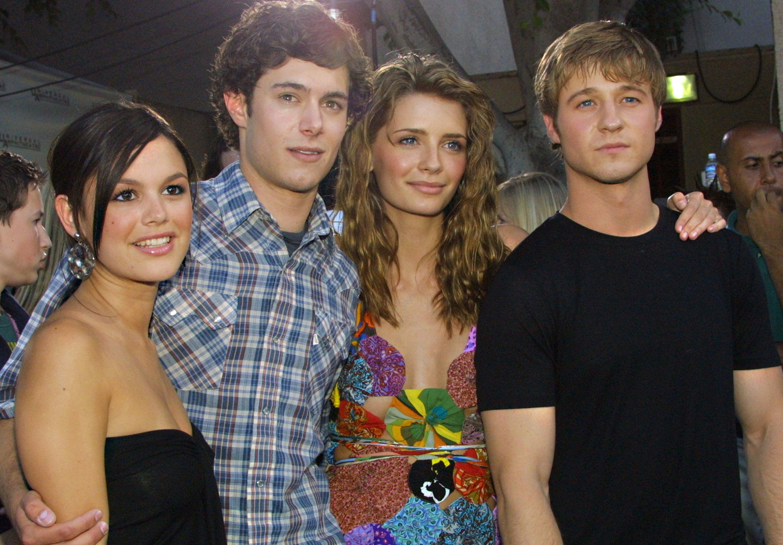 Rachel poses with Adam, Mischa, and Ben