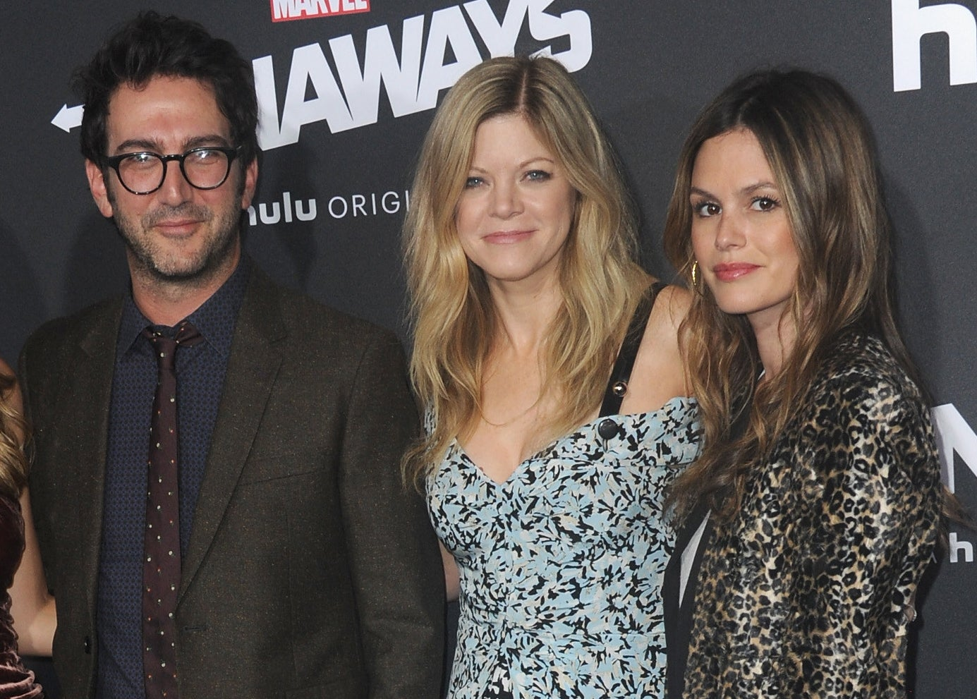 Rachel poses with Stephanie and Josh at an event