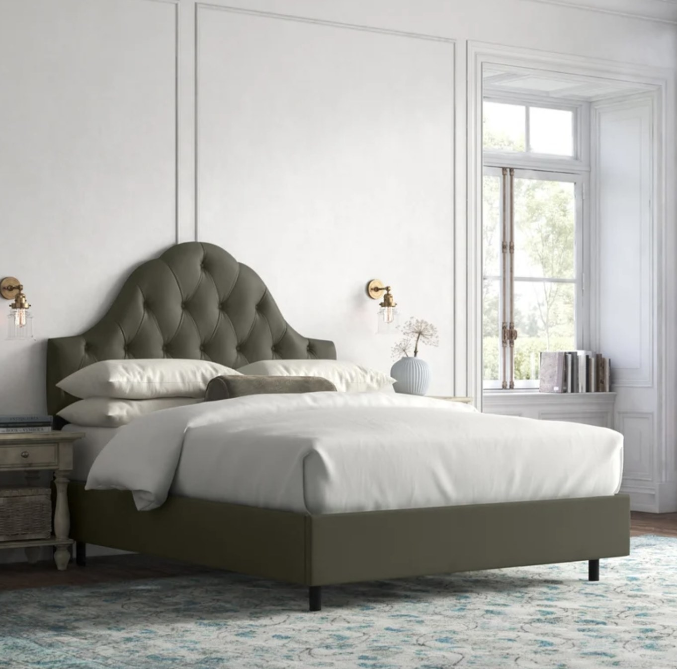 the headboard in pewter with sheets, a comforter, and pillows atop it