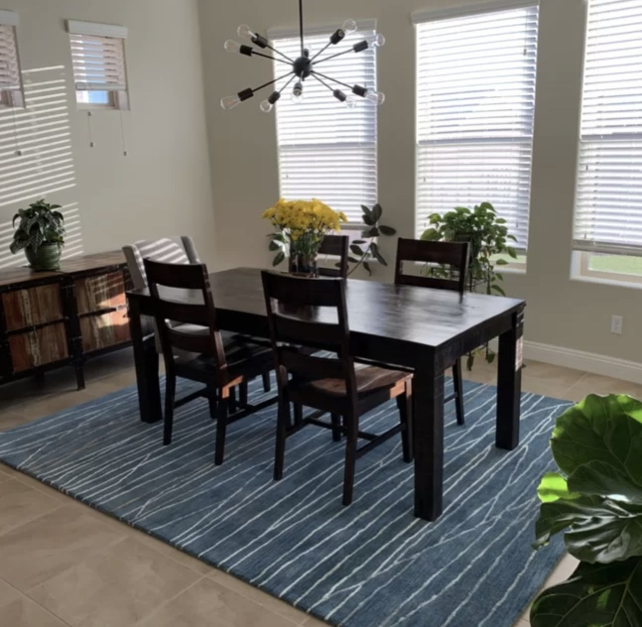 the rug in the darker blue color inside a reviewer's dining room